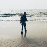 Me walking on the beach in Korea taking a moment to be sensitive by myself. It's a winters day, so I'm all wrapped up.